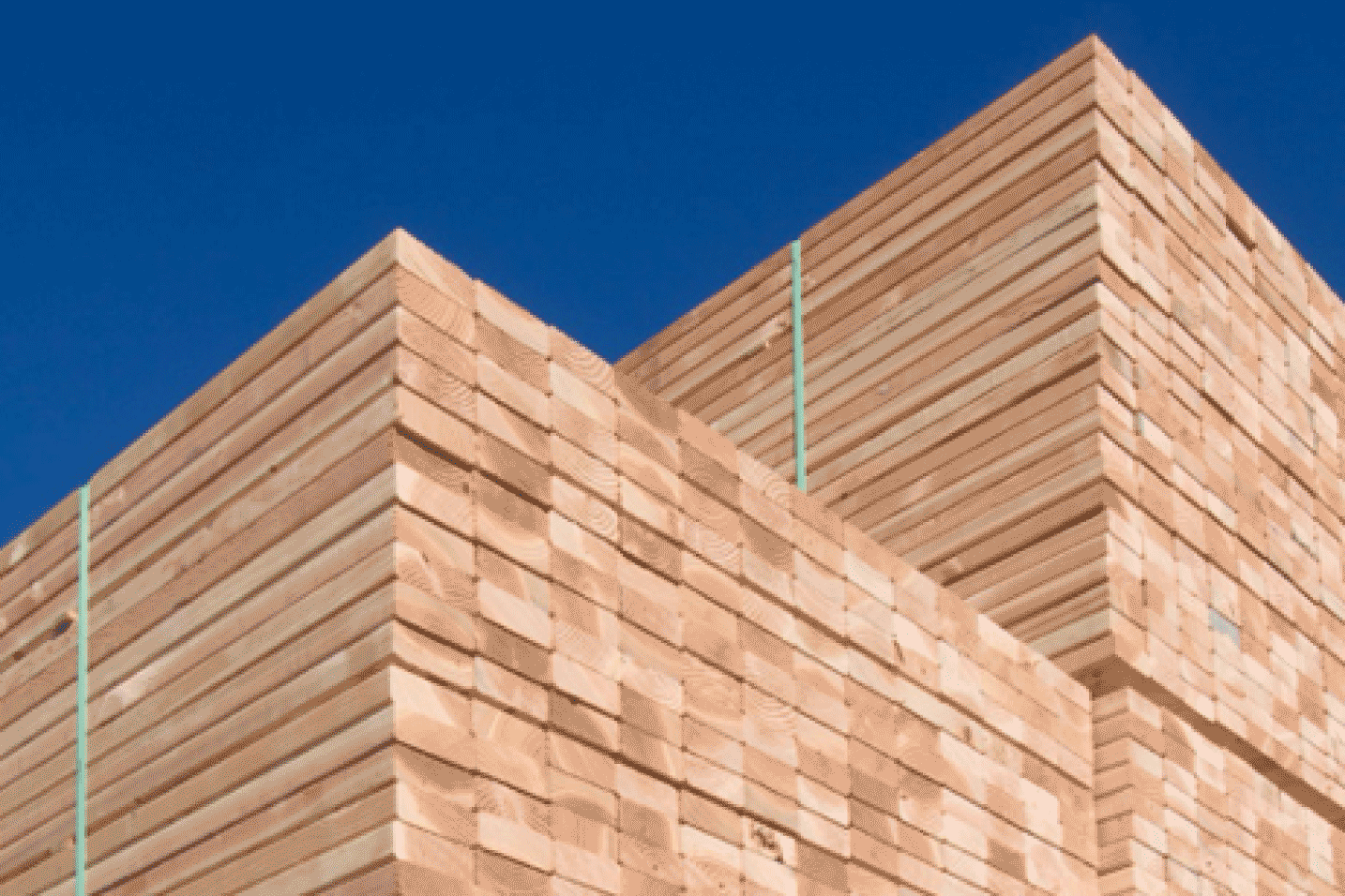 Lumber Pile with Blue Sky
